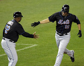 Jeff Francoeur is congratulated after he belts his first HR since being acquired by the Mets on July 10.  (AP)
