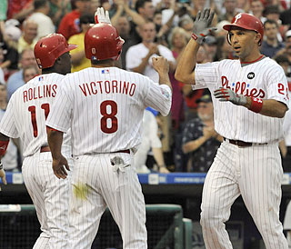 Raul Ibanez (right) makes it 3-0 in the first and receives props for his 25th homer of the season.  (US Presswire)