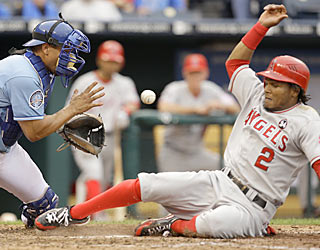 Erick Aybar, who beats the throw to home in the sixth, contributes with three hits, three runs and one RBI. (AP)