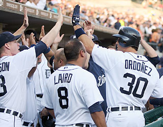 Magglio Ordonez ignites the Tigers' five-run first inning with a grand slam off Garrett Olson.  (AP)