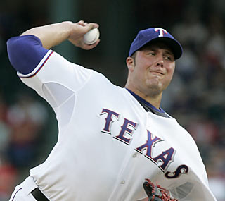 The Rangers ride the hot arm of rookie Tommy Hunter, who outduels Red Sox All-Star Josh Beckett.  (AP)