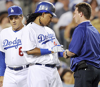 Manager Joe Torre doesn't need this. Manny Ramirez is hit by a pitch, but the X-rays are negative. (AP)