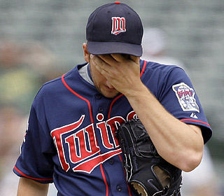 Maybe starter Glen Perkins should have called in sick. He surrenders eight runs on six hits in one inning.  (AP)