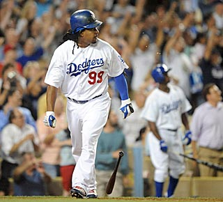 Pandemonium ensues as Manny Ramirez provides a dramatic flourish to his bobblehead night.  (US Presswire)