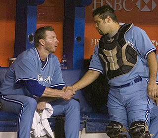Roy Halladay shakes catcher Rod Barajas' hand perhaps for the last time in a Blue Jays uniform. (AP)