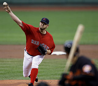 Brad Penny allows only five hits in improving to 5-1 at Fenway Park this season. (AP)