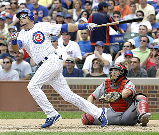 Aramis Ramirez watches the flight of his second homer in as many days, a two-run shot in the first inning. (AP)