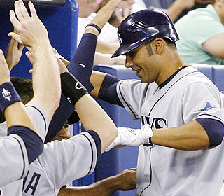 Carlos Pena brings the Rays to within a run with a ninth-inning homer. Willy Aybar ties it later. (AP)