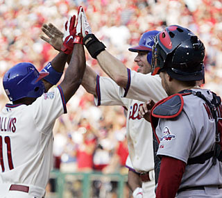 Jimmy Rollins (left) hits a grand slam in the fifth and finishes with a career-high five RBI. (AP)