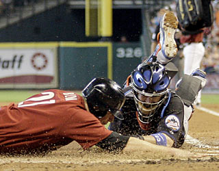 The Mets don't just use their bats to get the job done as catcher Brian Schneider displays in the first inning.  (AP)