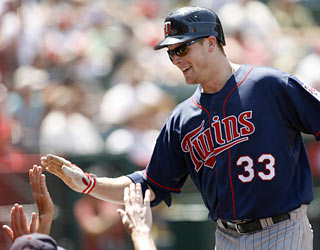 The Twins' Justin Morneau is all smiles as he notches his 12th career multihomer game.  (AP)