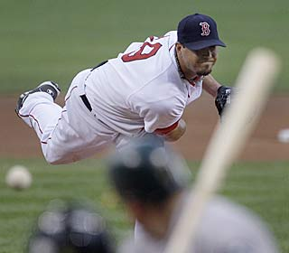 Josh Beckett strikes out 10 in seven innings to get his AL-leading 12th victory.  (AP)