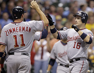 Josh Willingham (16) doubles his career grand slam total with long drives in the fifth and sixth innings.  (AP)