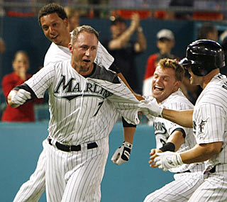 The Marlins swarm pinch-hitter Ross Gload after he unleashes a walk-off home run.  (AP)