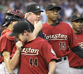 The Astros turn to their bullpen after Roy Oswalt (44) leaves with a strained back in the second inning.  (AP)