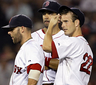 Nick Green (right) commits two errors in the ninth and the Red Sox lose a three-run lead.  (AP)