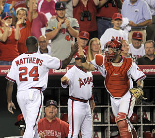 Gary Matthews Jr. hears it from teammates and fans after his bases-clearing double in the eighth.  (AP)