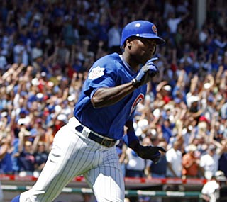 Alfonso Soriano reacts after belting a three-run homer in the first inning to spark a Chicago rout.  (AP)