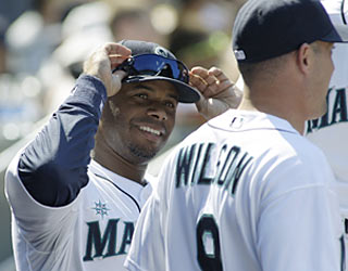 Ken Griffey Jr., who drives in the go-ahead runs, shows new teammate Jack Wilson he's still got the goods.  (AP)