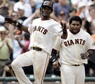 Eugenio Velez (left) accounts for the game's only run in the bottom of the 10th inning.  (AP)