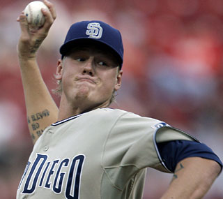 Mat Latos yields just a solo homer in seven sterling innings and lets the bullpen do the rest.  (AP)