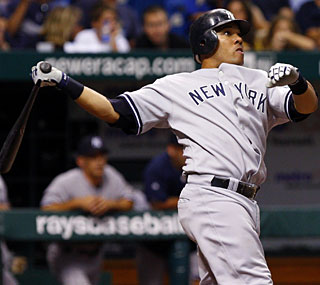 Melky Cabrera slams a solo shot in the ninth inning as the Yankees drop the Rays.  (US Presswire)