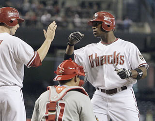 Justin Upton (right) plays a pivotal role in the D-Backs win by providing a home run and three RBI.  (AP)