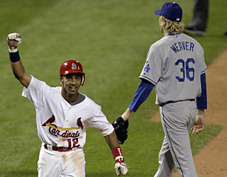 Julio Lugo trots home victoriously after Albert Pujols sends a shot over the center fielder in the 15th.  (AP)