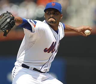 Facing the Rockies for the first time, Johan Santana fans eight and allows four hits over seven innings. (AP)
