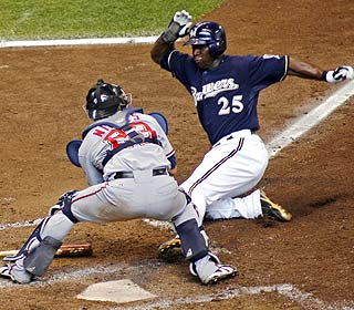 Mike Cameron beats out the tag and helps the Brewers salvage a split with the Nats. (AP)