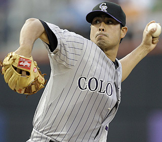 Jorge De La Rosa makes sure the Rockies avoid a sweep and improves his July stats to 5-0 with a 2.50 ERA.  (AP)