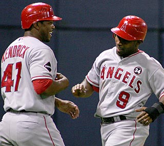 Howie Kendrick (left) and Chone Figgins are all smiles as the Angels use a big 11th to beat the Twins.  (AP)