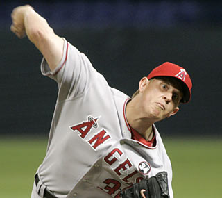 Jered Weaver does his part on the mound as he strikes out a career-high 11 batters.  (AP)