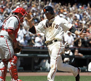 Newly acquired Freddy Sanchez gathers two hits and two RBI in his first game with the Giants.  (AP)