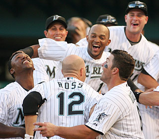 Cody Ross' second home run of the afternoon and 17th of the season is worth a Marlins celebration.  (AP)