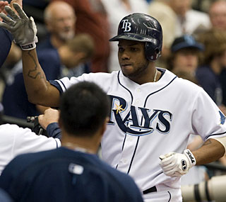 Willy Aybar goes deep from both sides of the plate as the Rays batter Zack Greinke.  (AP)