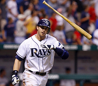 Evan Longoria knows the game is over as he flips the bat after turning on a Takashi Saito pitch ...