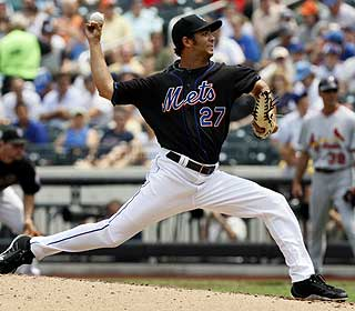 Nelson Figueroa pitches 4 1/3 scoreless innings and also hits a triple in relief of an injured Jonathon Niese.  (AP)