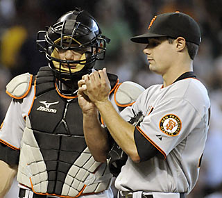 Catcher Eli Whiteside assists pitcher Joe Martinez during the game, especially with his first career home run.  (AP)