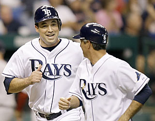 Pat Burrell provides a solo shot off Brad Penny to help the Rays go up 5-2 in the sixth inning.  (AP)