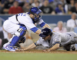 Russell Martin tags out Craig Counsell, but not before the Brewers score three in the fourth.  (AP)
