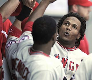 Erick Aybar gets a round of congratulations after hitting one of the Halos' four dingers.  (AP)