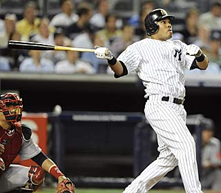Melky Cabrera hits one of the Yankees' two three-run homers in New York's eight-run fourth.  (Getty Images)