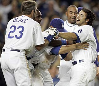 Andre Ethier (right) is greeted by teammates after his league-leading fifth walk-off hit.  (AP)