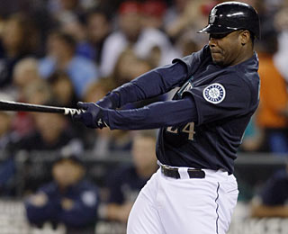 It's only fitting that Ken Griffey Jr. hits a home run (12) on the night of his bobblehead dolls. (AP)
