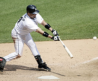 Placido Polanco gets his bat on the ball and delivers in the eighth with an RBI single.  (AP)