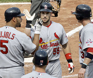 Skip Schumaker (55) receives props for his first career pinch-hit homer, which sparks a five-run inning.  (AP)