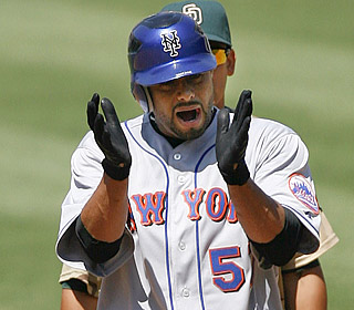 Winning pitcher Johan Santana applauds himself after knocking in Jeff Francoeur with a sixth-inning single.  (AP)