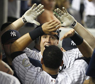 A wide-eyed Mark Teixeira celebrates his first game-winning hit against the Red Sox -- as a Yankee.  (AP)