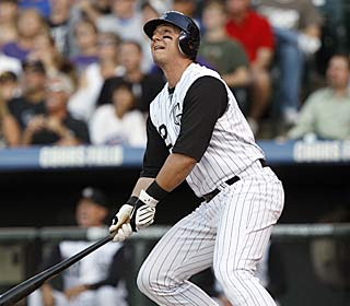 Troy Tulowitzki crushes his 21st homer en route to his first cycle and a career-best seven RBI.  (AP)